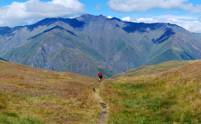 Lonely footpath Caucasus mountains royalty free stock image