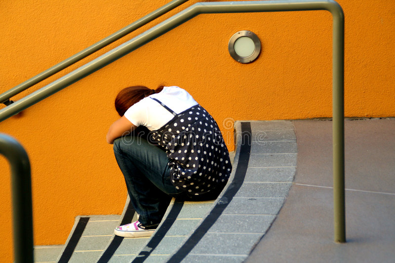 Lonely girl on stairs royalty free stock photo