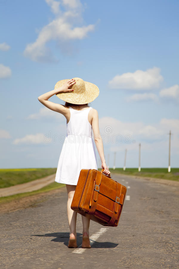 Download Lonely Girl With Suitcase At Country Road. Stock Photo - Image: 19374000