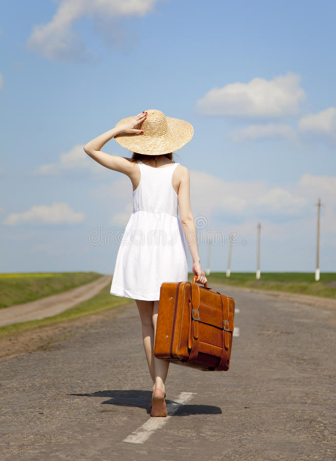 Free Lonely Girl With Suitcase At Country Road. Royalty Free Stock Photo - 23423115
