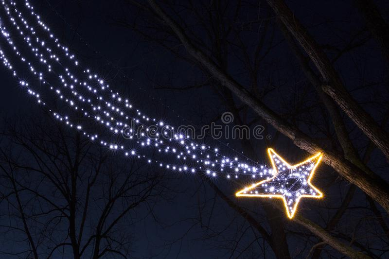 Christmas garland light bulbs falling star in the night royalty free stock images