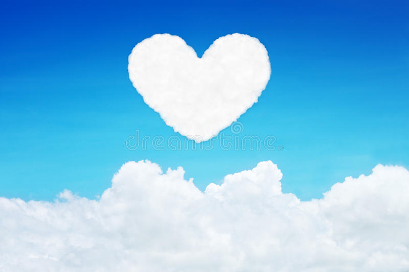 lonely heart shaped clouds on blue sky stock image