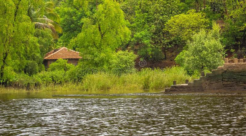 Lonely hose of an indian village. Lonely Indian village house by a water body royalty free stock photos