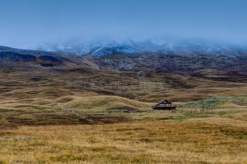 Lonely house in Icelandic Landscape with fog mountains with snow stock photos