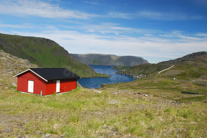 Lonely house in Mageroya Island. Lonely wooden house close to Nordkapp in wild nordic Mageroya Island, surrounded by tundra. Some fisher's small village and see royalty free stock photo