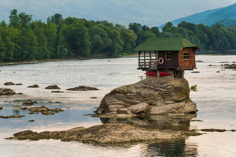 Lonely house on the river Drina in Bajina Basta, Serbia. Bajina Basta, Serbia July 31, 2017: Lonely house on the river Drina in Bajina Basta, Serbia royalty free stock photos
