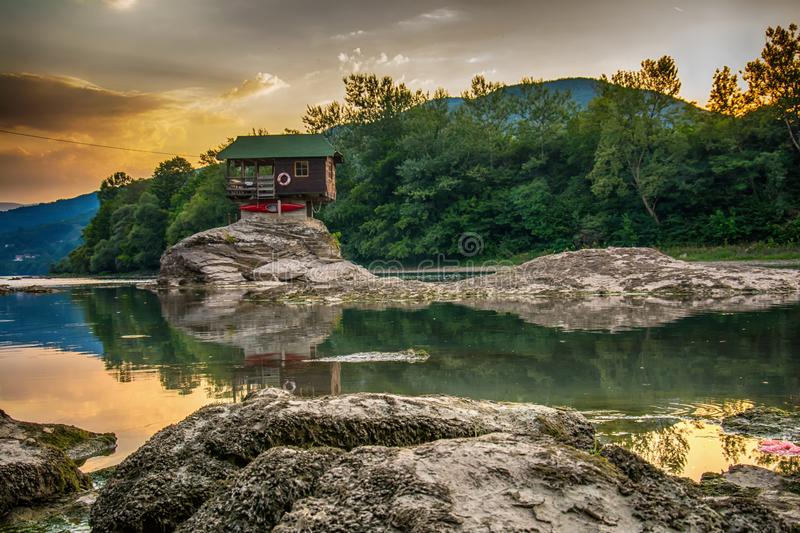 Lonely house on the river Drina in Bajina Basta, Serbia. Bajina Basta, Serbia July 31, 2017: Lonely house on the river Drina in Bajina Basta, Serbia stock images