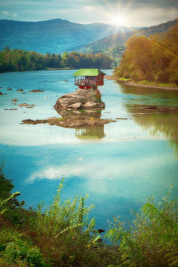 Lonely house on the river Drina in Bajina Basta, Serbia. BAJNA BASTA, SERBIA - 20. OCTOBER 2018. Beautiful lonely house on the river Drina. Day editorial shot stock photography