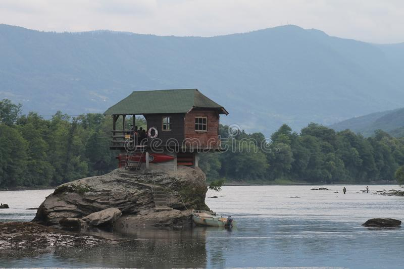 Lonely house on the river Drina in Bajina Basta, Serbia. Cabin, forest. Colorful little house on the rock on the middle of the Drina river in west Serbia, one royalty free stock image