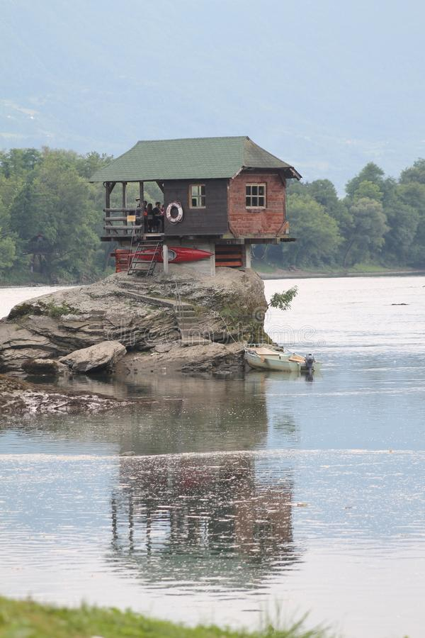 Lonely house on the river Drina in Bajina Basta, Serbia. Cabin, forest. Colorful little house on the rock on the middle of the Drina river in west Serbia, one stock photography