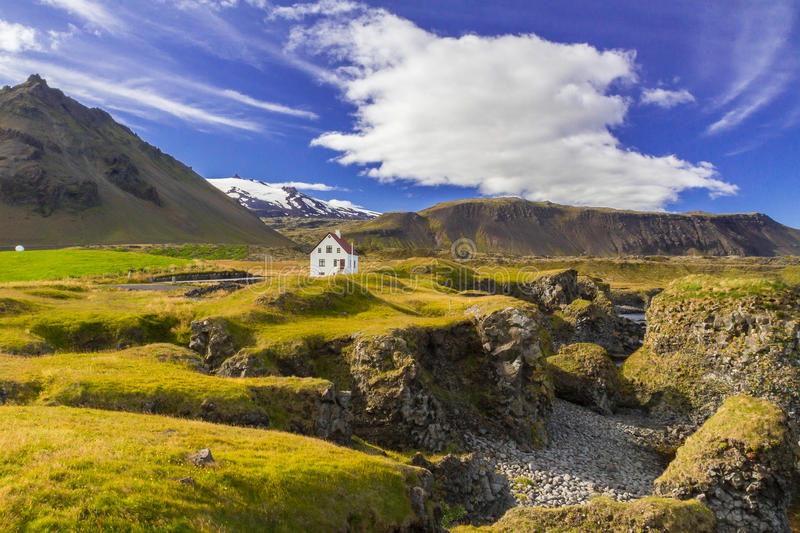 Secluded house in the middle of stunning Icelandic landscape. A landscape of a secluded house in the western fjords of Iceland stock photo