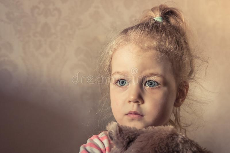 Lonely innocence scared child girl looking frightened with worried sight stock images