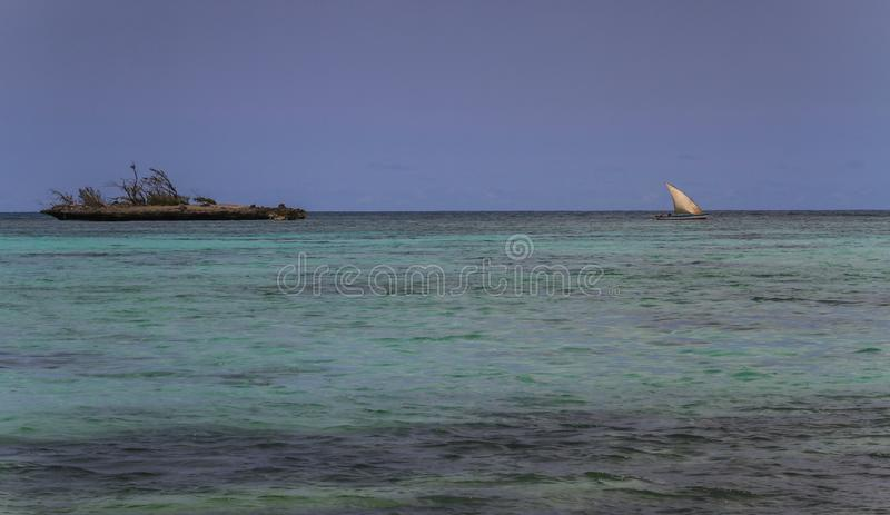 Lonely island, Emerald sea, traditonal sailboats, diana, northern madagascar. The Emerald Sea Mer d`Emeraude is located north of the passage to Diego Suarez Bay royalty free stock photo
