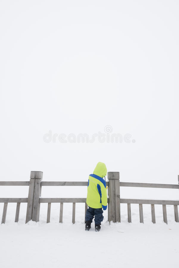 Lonely kid in snow royalty free stock images