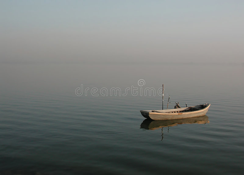 Lonely lagoon boat - calmness royalty free stock image