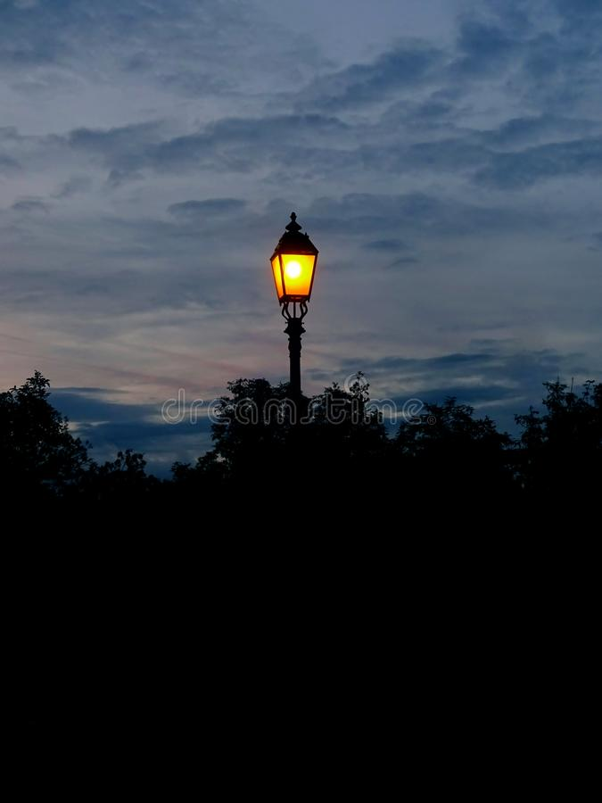 Lonely lantern. At night illuminates the path of the same lonely people stock images