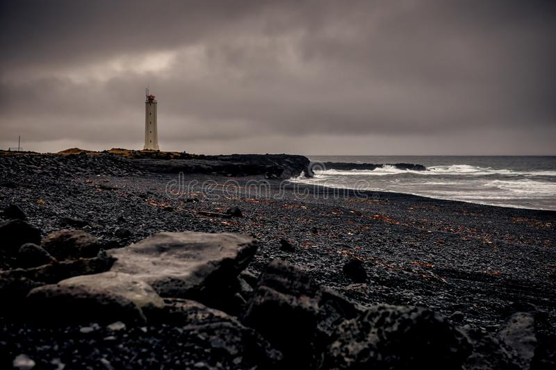A lonely lighthouse in iceland. This picture shows a lonely lighthouse in the bleakness of Iceland stock images