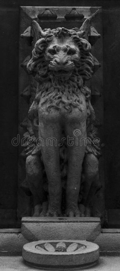 Lonely lion standing still. Shot in black and white detail on the facade of this historic building representing some character, animal or flower. Set in Eixample stock images