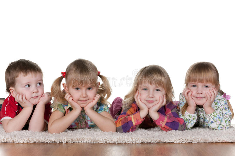 Lonely little boy at three beautiful girls royalty free stock images