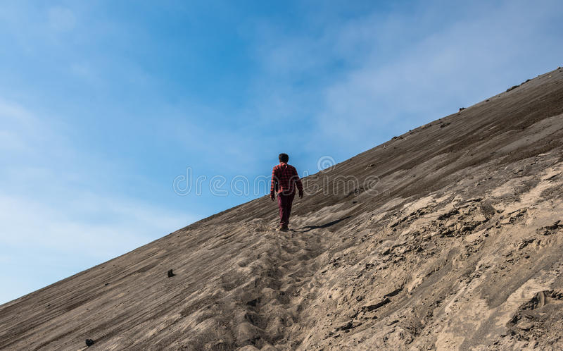 Lonely man going ahead through the desert royalty free stock images