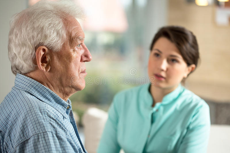 Lonely man in retirement home. Lonely senior men staying in retirement home royalty free stock photography