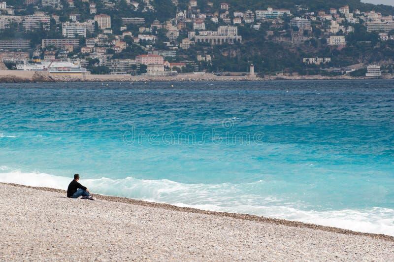 Lonely man at a seashore royalty free stock image