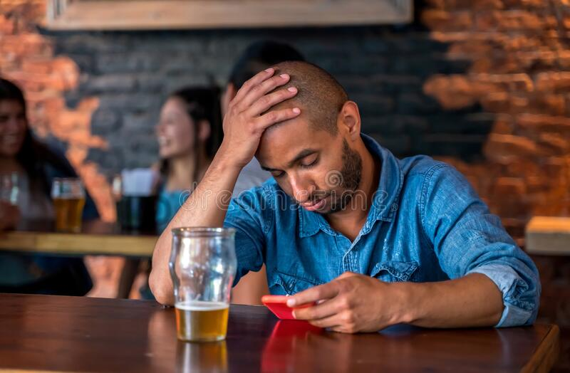 A lonely man sitting at the bar royalty free stock photos
