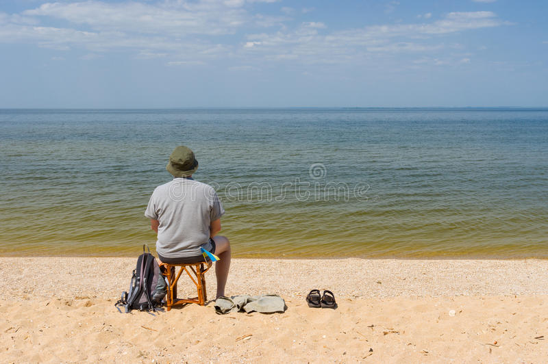 Lonely man sitting by the Dnepr river. Ukraine royalty free stock photo