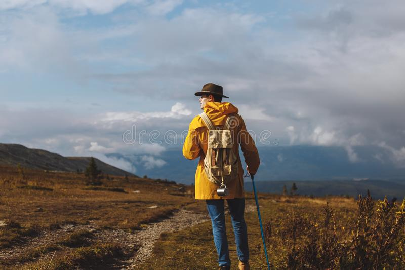 Lonely man strolling outdoors, loneliness concept royalty free stock photography