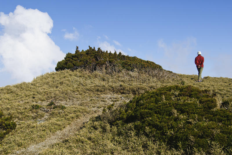 Lonely man walk in the mountain trail. royalty free stock images
