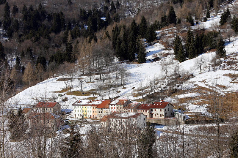 Lonely Mountain Village with snow-covered roofs. In winter stock photo