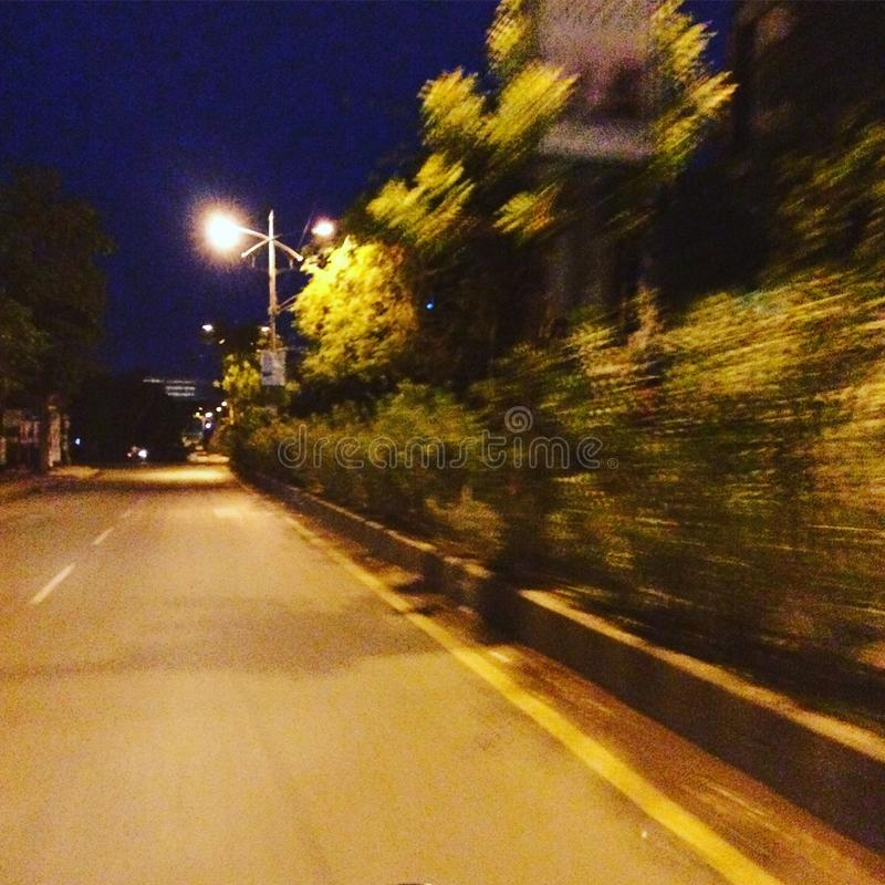 A lonely yet moving road view royalty free stock photography