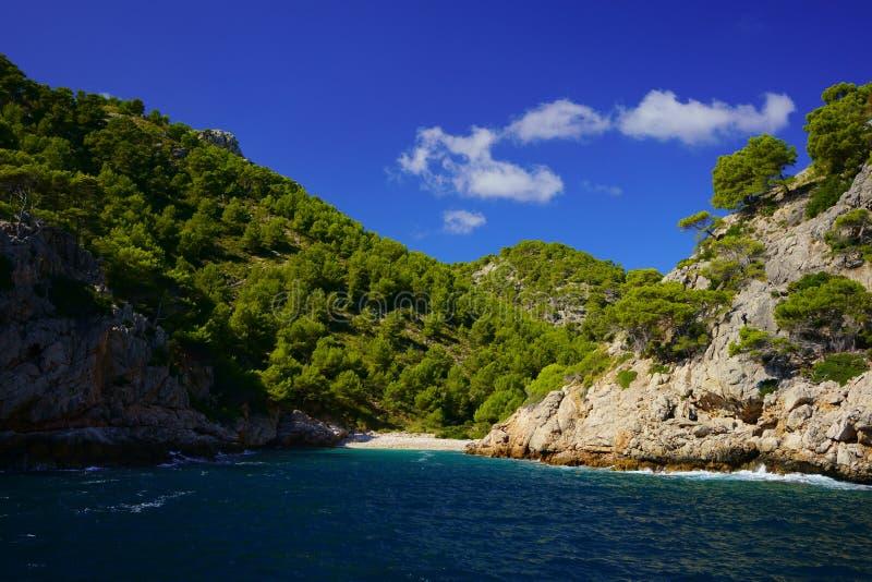 A lonely, natural and heavenly beach in northern Mallorca, Balearic Islands, Spain. Secluded beach Cala en Feliu near Cala Murta, Port de Pollenca, Mallorca stock images