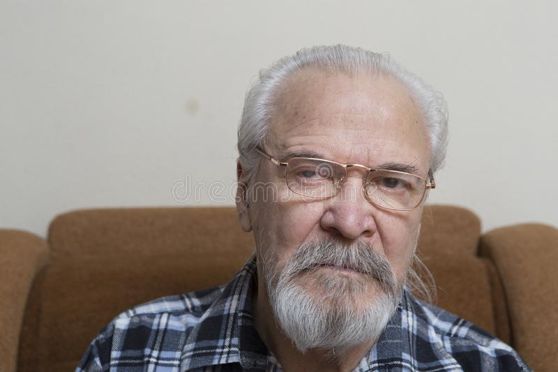Lonely old man with sore eyes stock photo
