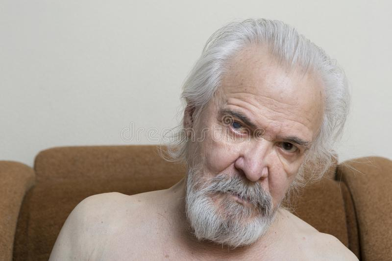 Lonely old man with sore eyes royalty free stock photography