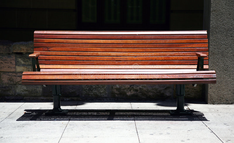 Lonely park bench royalty free stock photo