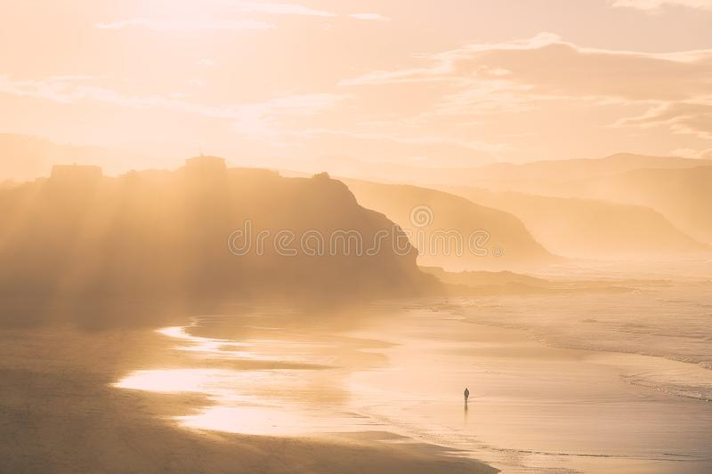 Lonely person alone in beach royalty free stock photography