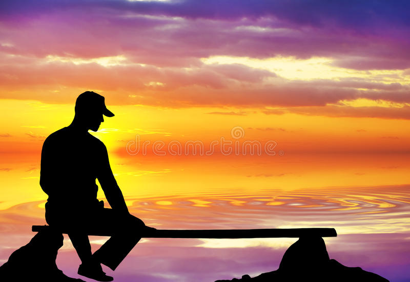 The lonely person sitting on breakage royalty free stock photography