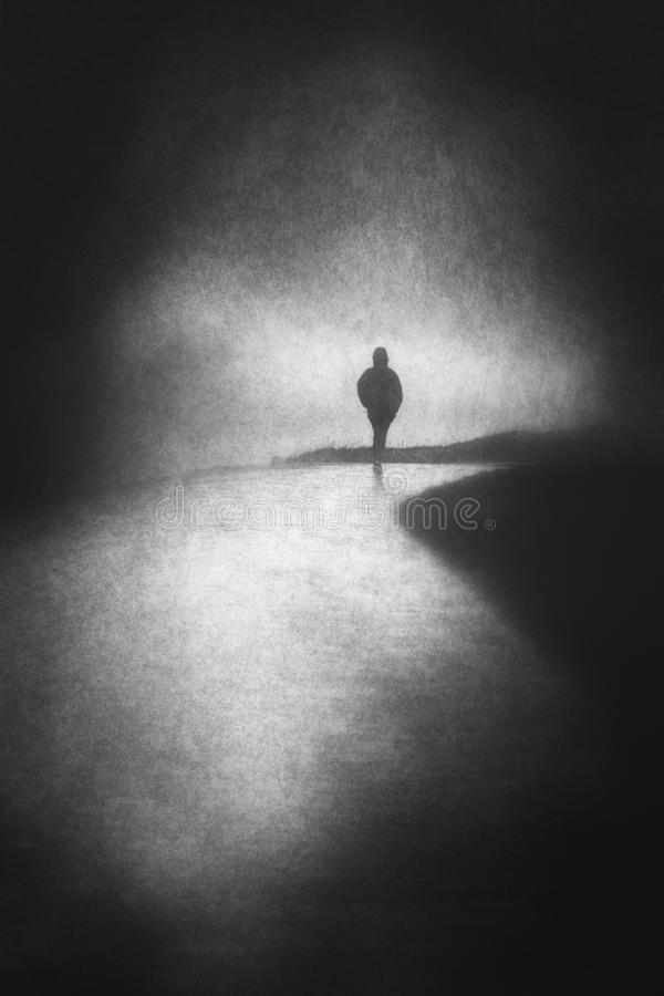 Lonely person walking royalty free stock photography