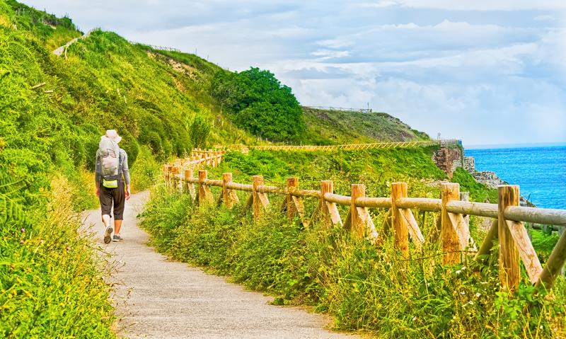 Lonely Pilgrim with backpack walking the Camino de Santiago in S stock photography