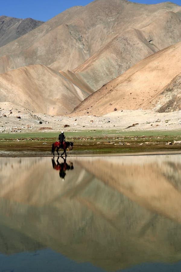 Lonely rider stock photo