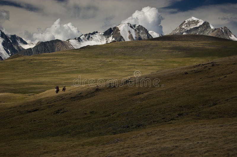 Lonely riders. In Altai mountains, Mongolia stock photos
