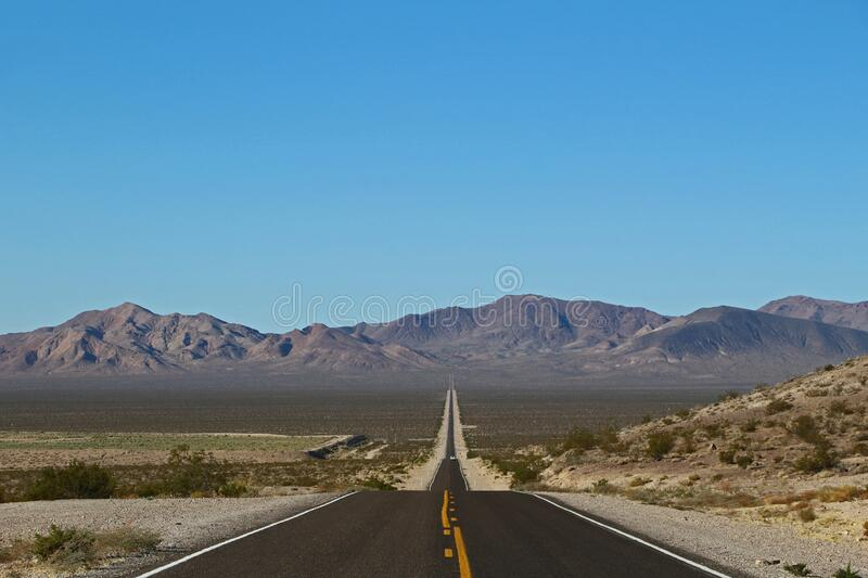 Lonely road in Death Valley National Park in the USA stock photos