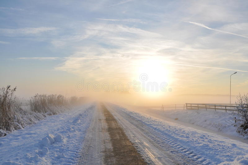 Lonely road in winter royalty free stock image