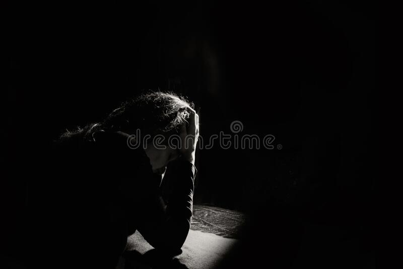 Lonely and sad girl holding her head stock photography