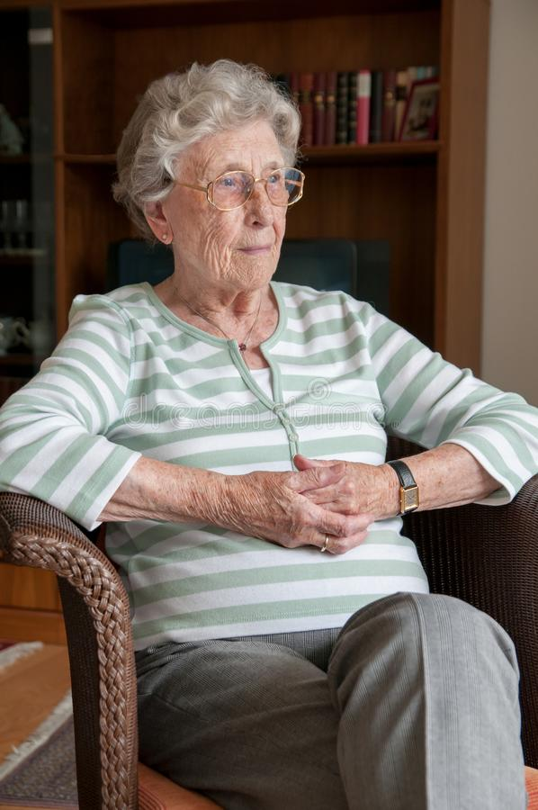 Portrait format of lonely senior woman stock image