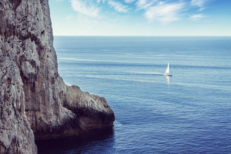 Download Lonely Sailboat Sailing On The Sea Stock Photo - Image of horizon, view: 85091262