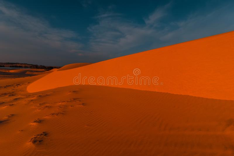 Lonely sand dunes. Sunset desert landscape royalty free stock photos