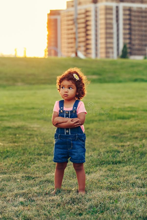 Lonely scared baby got lost in big city. stock images