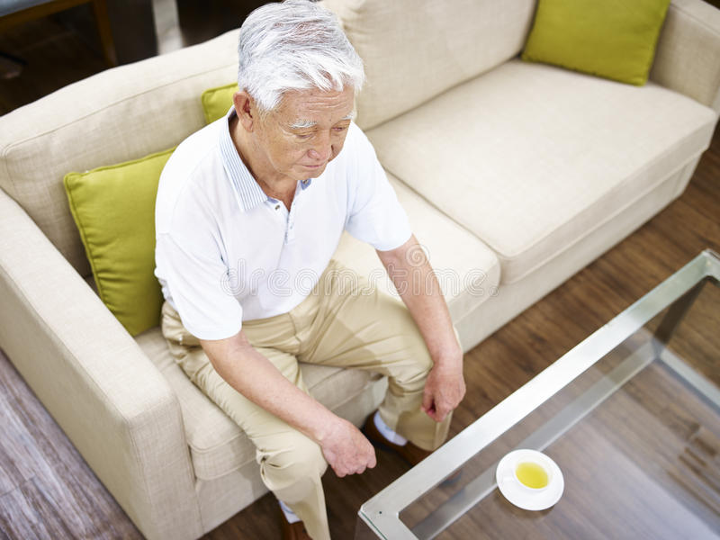 Lonely senior asian man royalty free stock photography